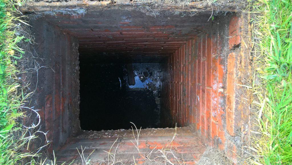 Entrance to brick built cesspit